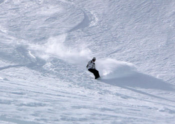 A picture of me snowboarding down the mountain
